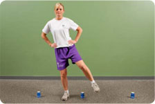 Side steps over cups/hurdles (with ball toss and external sports cord resistance), increase speed